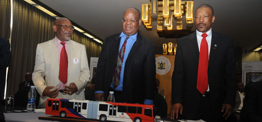 Historic moment: Executive Mayor Amos Masondo flanked by Top Six Taxi Association chairman Sicelo Mabaso and chairman of the Greater Johannesburg Regional Taxi Council Eric Motshwane